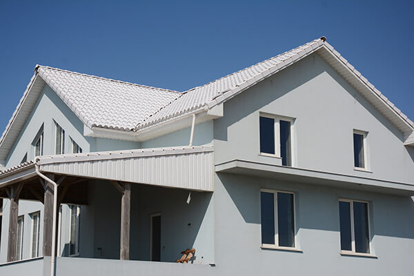 A house with white tile roof for energy saving.