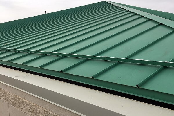 standing-seam-metal-roof-under-construction.jpg