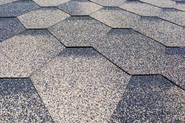 close up of grayish architectural shingle roofing with unique design