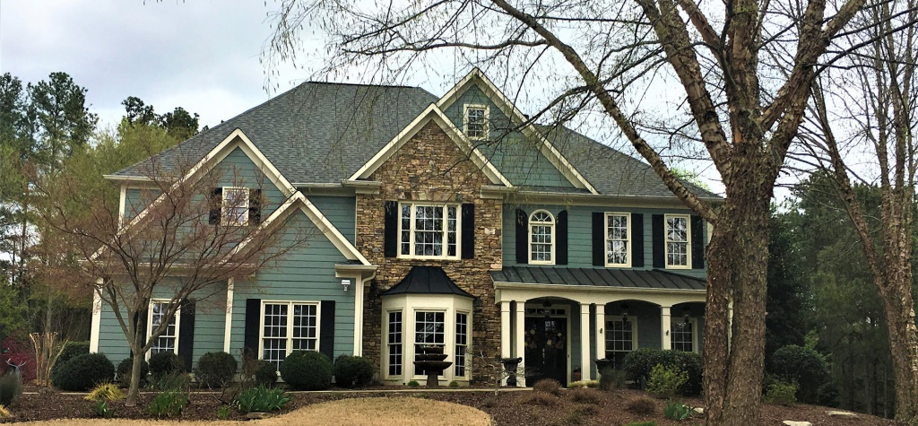 An attractive residence with stone veneer entrance.