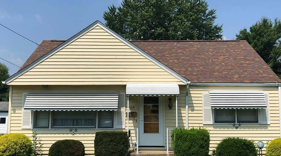 A beautiful residential home with restored siding.